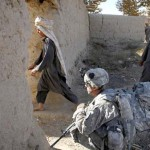 Afghanis-pass-a-U.S.-Army-soldier-from-First-Battalion